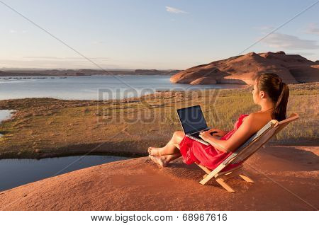 Girl Working While At Lake Powell