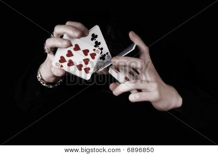 Young Magicians Hands Holding A Lot Of Play Cards. Black Background
