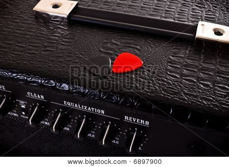Two Plectrums On Guitar Amplifier