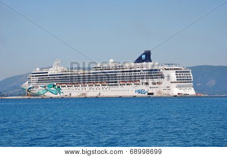 CORFU, GREECE - JUNE 23, 2014: Passenger cruise ship Norwegian Jade moored in Kerkira harbour on the Greek island of Corfu. The 294mtr ship was built in Germany in 2006.