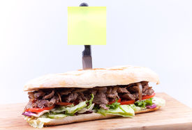 Steak Sandwich With Yellow Note Paper
