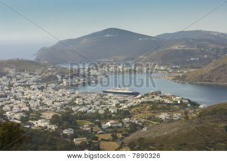 cityscape and harbor of Skala of Patmos island on a misty background Greece poster