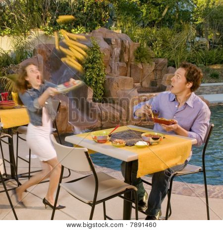 Woman Spilling Her Food At Poolside