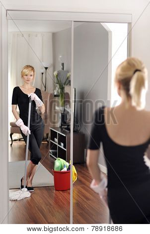 Woman with detergent in house clean floor poster