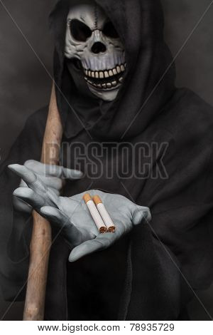 The concept: smoking kills. Angel of death holding cigarette