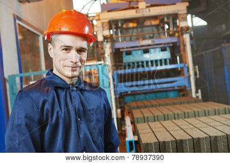 industrial engineer worker operating control panel system at modern manufacture plant