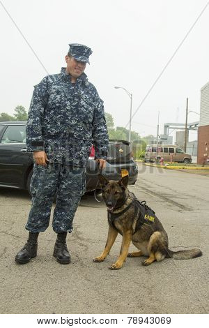 Unidentified navy with K-9 dog providing security during Fleet Week