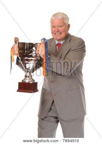 Successful Mature Businessman Holding Trophy