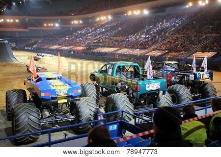 MOSCOW, RUSSIA - MAR 29, 2014: Big jeeps with huge wheels at show Monster X Tour in Sports Complex