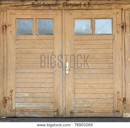 Old light brown garage door with windows