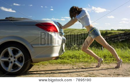 Woman Is Pushing Broken Car