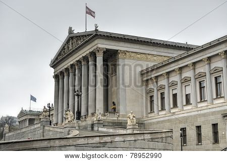 The historic building of the Austrian Parliament in Vienna poster