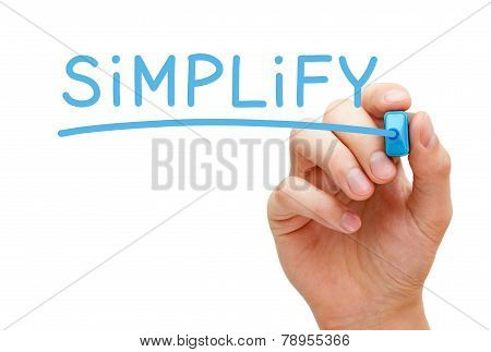 Hand writing Simplify with blue marker on transparent wipe board isolated on white. poster