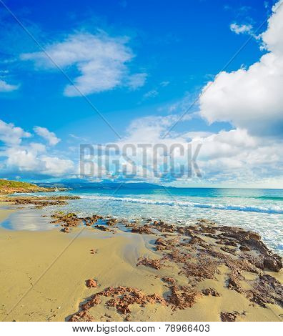 Brown Rocks In Le Bombarde Beach