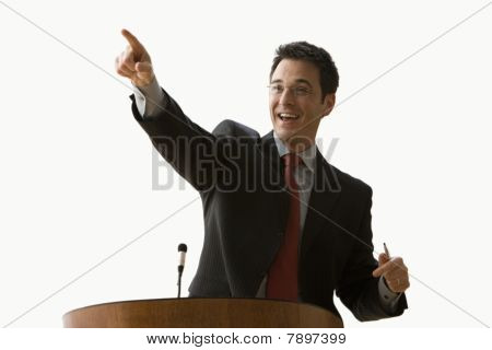 Businessman Smiling and Pointing - Isolated