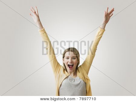 Excited Woman with Arms in the Air