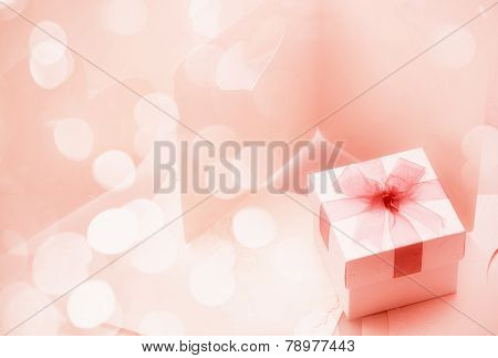The Small gift box on around of bogey pink tone for background