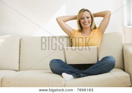 Woman Relaxing with Laptop