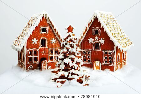 The Hand-made Eatable Gingerbread Houses And New Year Tree With Snow Decoration