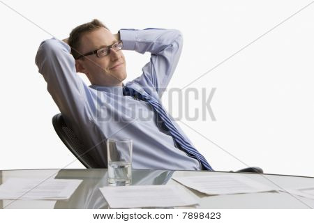 Businessman Sitting at Desk - Isolated