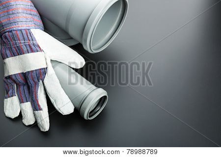 Building glove and soil-pipe on grey
