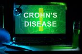 Notebook with words  crohn's disease , test tubes and stethoscope poster
