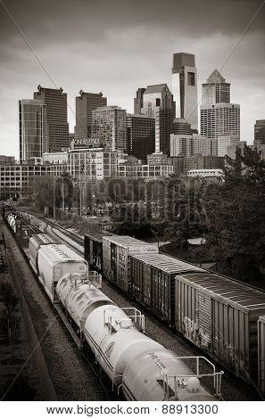 PHILADELPHIA, PENNSYLVANIA - MAR 26: city skyline with cargo train on March 26, 2015 in Philadelphia. It is the largest city in Pennsylvania and the fifth in the United States.