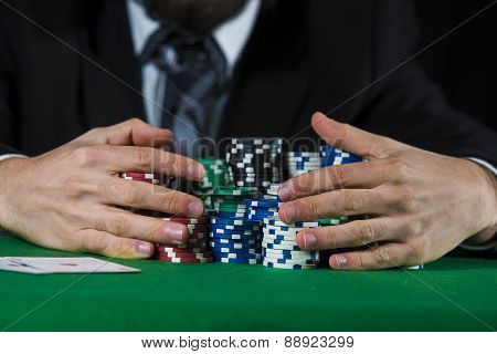 Man betting on the casino in close up poster