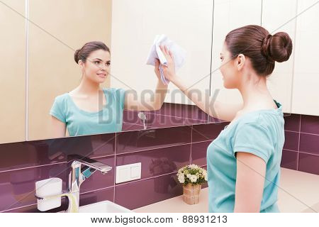 Young pretty brunette cleaning tap