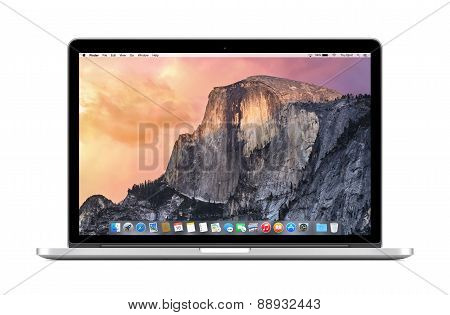 Directly Front View Of Apple 15 Inch Macbook Pro Retina With Os X Yosemite On The Display