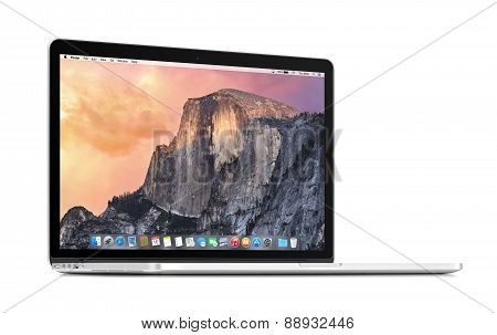Front View Of A Rotated At A Slight Angle Apple Macbook Pro Retina 15 With Os X Yosemite On The Disp