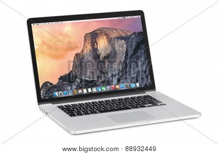 Apple 15 Inch Macbook Pro Retina With Os X Yosemite On The Tilted Back Monitor