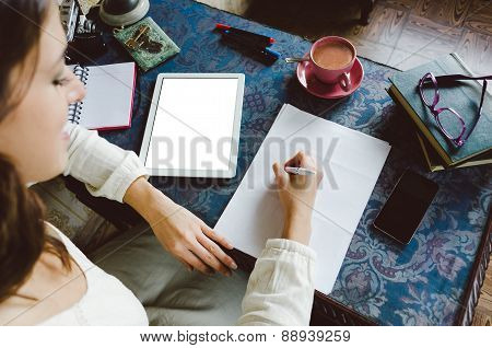 Woman Writing And Working At Home