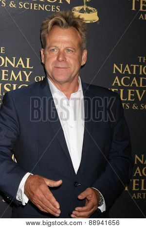 LOS ANGELES - FEB 24:  Kin Shriner at the Daytime Emmy Creative Arts Awards 2015 at the Universal Hilton Hotel on April 24, 2015 in Los Angeles, CA