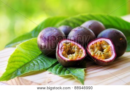Passion Fruits On Wooden Table