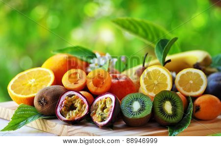 Fruits With Leafs On Table On Green Background