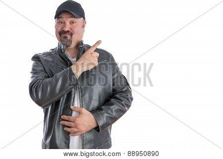 Jaunty Trendy Man Pointing To Blank Copyspace