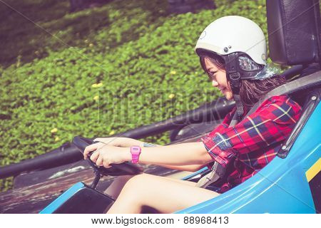 Cute Thai Girl Is Driving Go-kart In Retro Color