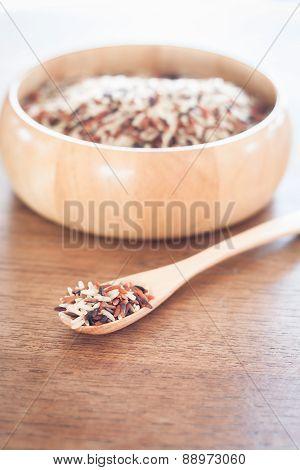 Organic Dry Multi Grain Rice In Wooden Bowl