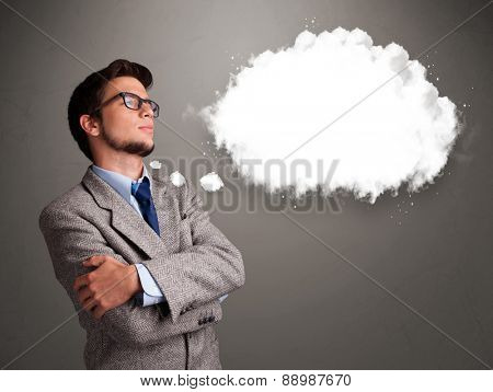 Good-looking young man thinking about cloud speech or thought bubble with copy space