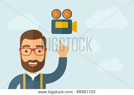 Man pointing the video camera ivon