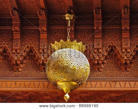 Traditional Moroccan lantern and cedar wood carved ceiling in Marrakech Morocco poster