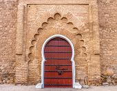 Traditional Moroccan style design of an ancient door at the Koutoubia Mosque in Marrakesh Morocco also known as Mosque of the Booksellers poster