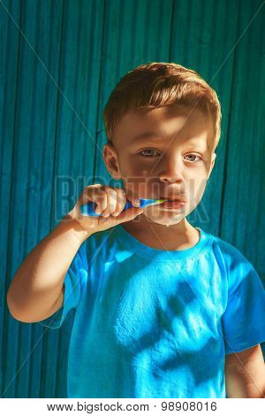 Boy Cleaning Teeth