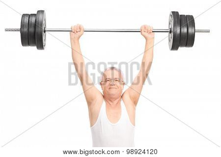 Senior lifting a heavy barbell and looking at the camera isolated on white background
