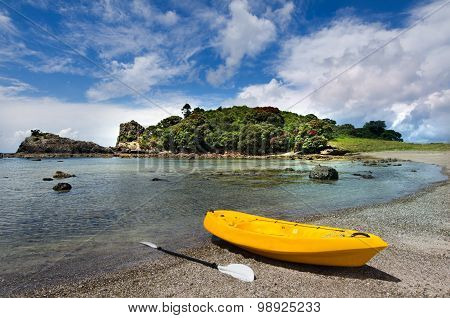 Yellow Kayak On The Shore