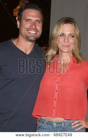 LOS ANGELES - AUG 15:  Joshua Morrow, Kelly Sullivan at the