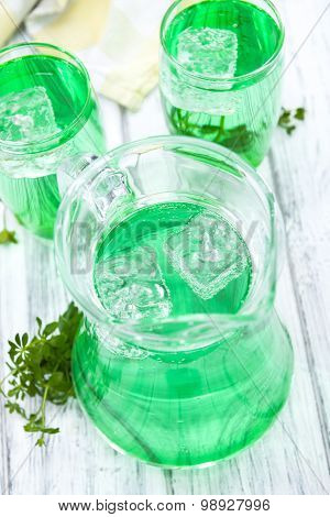 Cold beverage with Woodruff taste in a glass poster