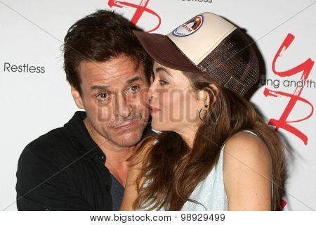 LOS ANGELES - AUG 15:  Christian LeBlanc, Amelia Heinle at the