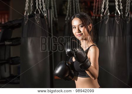 Portrait of sporty fit Asian model of boxing gym